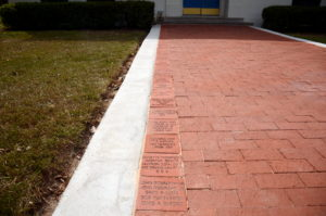 "The 8""x8"" bricks on the left of the walkway."